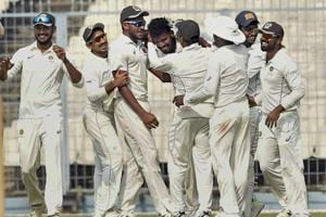 Kerala bowler MD Nidheesh celebrates with his teammates during the Ranji Trophy match against Bengal.