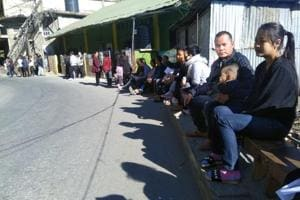 Voters wait outside a polling booth in Aizawl South. Unlike many other states, provision is made for voters to sit outside polling booths while waiting for their turn.