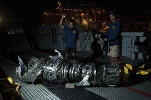Navy divers inspect what is believed to be engine of the crashed Lion Air jet after it was retrieved from the sea floor, at Tanjung Priok Port in Jakarta, Indonesia.