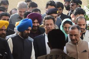 Pakistan Prime Minister Imran Khan (C) and alongside Indian Minister for Food Processing Industries Harsimrat Kaur Badal (2R) and India