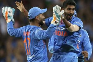 Jasprit Bumrah, right, is congratulated by teammate India