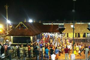 Sabarimala: Devotees pay obeisance Lord Ayyappa temple in Sabarimala. Kerala has been witnessing massive protests by Ayyappa devotees opposing the entry of girls and women of menstrual age into the Sabarimala temple since the government decided to implement the apex court order. (File Photo)