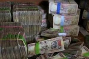 A pile of spiked Indian currency notes of 1,000 denomination are seen after they were deposited by people at a bank in Bangalore, India.  The Congress which has attacked the Narendra Modi government over the Nov 8, 2016 note ban renewed its attack after former chief economic advisor Arvind Subramanian criticised the decision  (File Photo)