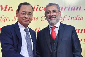 CJI Justice Ranjan Gogoi (L) shakes hands with Justice Kurian Joseph during the latter