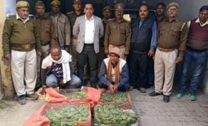 Police and forest officials with the rescued parakeets and the arrested bus driver and conductor in Ayodhya.