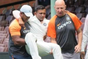 Prithvi Shaw being carried off the pitch by the BCCI medical team.