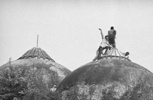 People climbing Babri Masjid in Ayodhya, Uttar Pradesh on December 6, 1992