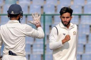 Punjab bowler Mayank Mankande celebrates after taking the wicket during Ranji Trophy cricket match against Delhi.