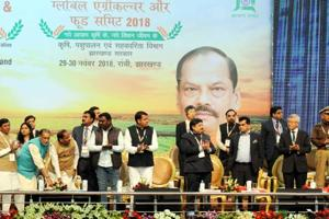 """Chief minister Raghubar Das ,union agriculture minister Radha Mohan Singh and others launching ground breaking with 50 companied on food processing during the """"Global Agriculture and Food Summit 2018"""" at Mega sports complex in Ranchi"""