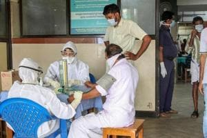 Doctors and patients wear safety masks as a precautionary measure after the