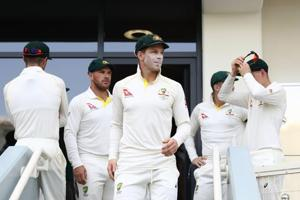 File image of Tim Paine leading his team out to field during a Test match.