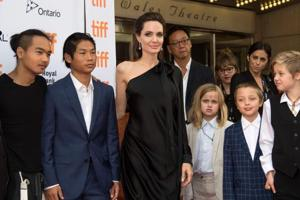 (L-R) Maddox Chivan Jolie-Pitt, Pax Thien Jolie-Pitt, Angelina Jolie, Vivienne Marcheline Jolie-Pitt, Knox Leon Jolie-Pitt and Shiloh Nouvel Jolie-Pitt at the premiere of First they Killed my Father at the Toronto International Film Festival in Toronto. (AFP)