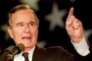 US President George Bush speaks to a large group of supporters during a campaign stop at the Sikorsky Memorial Airport in Connecticut in 01 November 1992 .