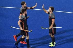 Jeroen Hertzberger of Netherlands celebrates with team mates after scoring the opening goal during the FIH Men