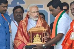PM Narendra Modi is felicitated by his party workers and leaders during an election rally ahead of the Telangana Assembly Elections at Nizamabad on Tuesday, November 27, 2018.