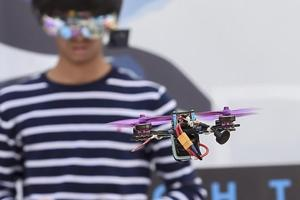 A drone pilot operates his drone during a practice session for the Night Drone Competition at the Bengaluru Tech Summit 2018, in Bengaluru, Nov. 29, 2018.