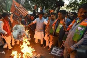 BJP workers stage a protest against Kerala Chief Minister Pinarayi Vijayan over alleged misconduct of the state police with a Union minister Pon Radhakrishnan at Sabarimala, outside the Kerala House in New Delhi