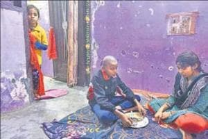 Sangeeta Sharma's children (right) have seen an outpouring of help from strangers ever since their mother was killed in a shootout between two gangs in north Delhi's Sant Nagar.