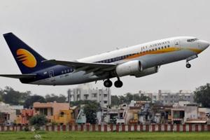 In the file photo, a Jet Airways passenger aircraft takes off from the airport in the western Indian city of Ahmedabad.