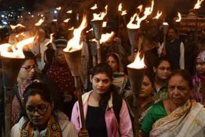 Survivors of the Bhopal gas tragedy along with others taking part in a torch rally taken out to pay tributes to the victims of the disaster on the eve of 34th anniversary in Bhopal on Sunday, December 2, 2018.