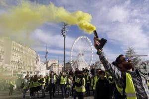 Demonstrators, known as they yellow jackets, protest in Marseille, southern France, Saturday, Dec. 1, 2018, against rising fuel costs and what they claim were dilapidated residential buildings that collapsed Monday Nov. 5, killing eight people.