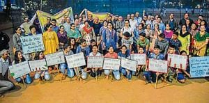 Residents protest against the proposal of road widening at Ideal colony on Sunday