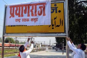 The file picture shows Rashtriya Rakshak Samuh activists covering  Allahabad Railway Junction board with poster of