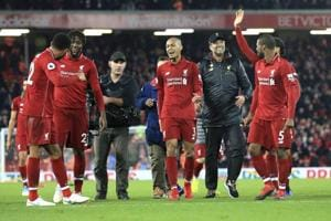 Liverpool coach Juergen Klopp (second from right) celebrates with the players after Divock Origi scored onSunday.