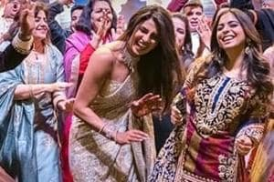 Bollywood actor Priyanka Chopra dances with guests during a ceremony before her wedding with Nick Jonas , at Umaid Bhawan in Jodhpur, India.