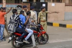 Police outside an examination centre for the Gujarat Police constable recruitment exam in Ahmedabad on Sunday. The exam was cancelled allegedly due to paperleak.