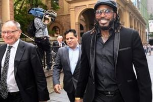 West Indies cricketer Chris Gayle reacts as he leaves the New South Wales Supreme Court after winning a defamation case against an Australian media company in Sydney.