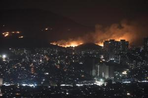 A major fire erupted in the Aarey forest near Goregaon , The fire broke out behind Infinity IT Park in Mumbai, India, on Monday, December 3, 2018.