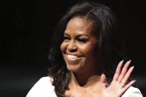 Michelle Obama acknowledges the crowd during her visit to the UK to publicise her memoir Becoming, at the Royal Festival Hall in London on Monday.
