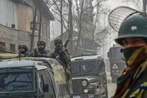 A CRPF jawan guards as army soldiers leave after an encounter with militants at Kuthipora village, Chattergam in Budgam district of central Kashmir. Image for representation.