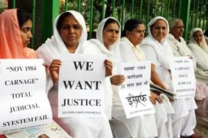 File photo of relatives of 1984 anti-Sikh riots victims during a protest in New Delhi.