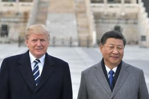 (In this file photo taken on November 8, 2017, US President Donald Trump, and Chinese President Xi Jinping pose at the Forbidden City in Beijing.  The trade war with China is an issue that predates Donald Trump's presidency.
