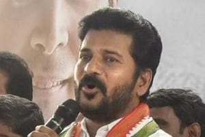 Telangana Congress working president A Revanth Reddy addresses the media in relation to the recent raid in his residence by Income Tax department, in Hyderabad.