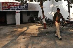 A police officer walks in the premises of a police station that was partially damaged by a mob during a protest on Monday in Chingrawti village of Bulandshahr district in Uttar Pradesh.