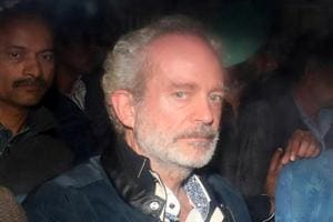 Christian Michel, a key accused and alleged middleman in AgustaWestland helicopter deal, is pictured inside a police vehicle outside a court in New Delhi on December 5, 2018.