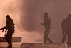 Smoke billows during clashes between protesters and security forces in south Kashmir