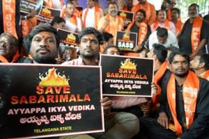 Members of the Sabarimala Ayyappa Seva Samajam pose with placards during a protest in Hyderabad on November 20, 2018, following the arrest of devotees at Sabarimala temple in Kerala.
