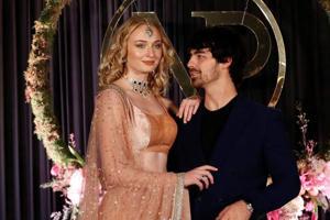Game of Thrones Sophie Turner and singer Joe Jonas pose during the wedding reception of Priyanka Chopra and American singer Nick Jonas in New Delhi on December 4, 2018.