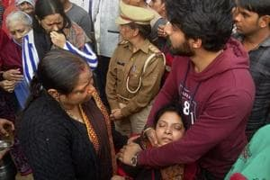 Family of slain UP policeman Subodh Kumar Singh mourn during his funeral in his village in Etah district, Tuesday, December 5, 2018.