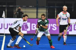 Germany player Johannes Grosse (L) and Pakistan player Ammad Butt (R) fight for the Ball during the field hockey group stage match between Germany and Pakistan at the 2018 Hockey World Cup in Bhubaneswar on December 1, 2018