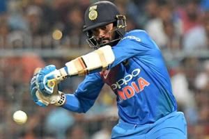 Dinesh Karthik plays a shot during the 1st T20 match against West Indies.