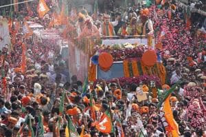 BJP National President Amit Shah showers flower petals during a road show for rajasthan assembly election in Ajmer