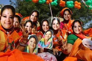 BJP supporters wear masks of Rajasthan chief minister Vasundhara Raje at an election rally, in Ajmer, Dec. 05, 2018.