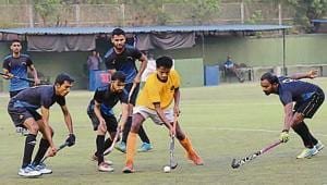 Aga Khan cup hockey tournament Lucknow (black) vs Pune Police (yellow) at Dhyanchand hockey stadium Pimpri in Pune