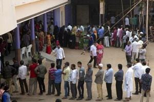 Telangana assembly elections 2018: People stand in a queue to cast their votes in Hyderabad.