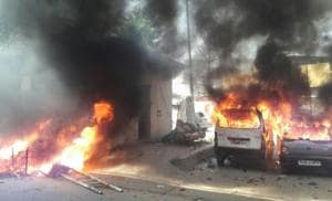 Vehicles torched by a mob which attacked policemen during a protest against Supreme Court ruling on SC/ST Act.